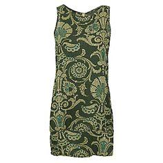Esta es una blusa y la pones en tu cuerpo. Es verde y verde claro. Tiene un patrón raro.
