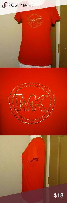 "MICHAEL KORS T-SHIRT-SIZE LARGE-WORN ONCE -Michael Kors T-shirt -Size Large -Only worn once -MK on the front made with gold sparkly embellishments -Perfect Condition  -Red, short sleeves -95% Cotton, 5% Elastane  -Armpit to armpit measures 20"" -Shoulder to bottom hem measures 25"" Michael Kors Tops Tees - Short Sleeve"
