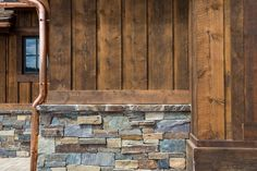 Board and batten with stone veneer (notice the finish/trim board above the stone ledge.  Copper pipe is a nice touch.