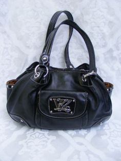 Kathy Van Zeeland Black Hobo Handbag with Silver color KVZ metal branding