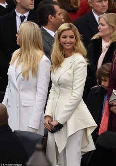 Ivanka accessorized her white coat with an American flat pin on the corner of her lapel...