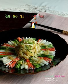 Cold Jellyfish Salad (Haepari Naengchae 해파리 냉채 )  dressing: 1T minced garlic 3T vinegar 2T sugar .5T soysauce 1T sesame oil 1t salt