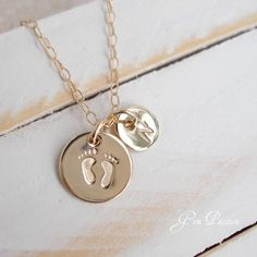 Tiny Feet Gold Disc - in silver Hand Stamped Disc Baby Feet - Handmade Mothers Day New Baby Monogram Initial. $35.00, via Etsy.