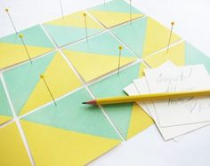 Painted geometric escort cards in our spring palette, lemon and mint. See more here: http://www.marthastewartweddings.com/302252/perfect-wedding-color-palette-lemon-and-mint/@center/272434/plan-your-wedding-color