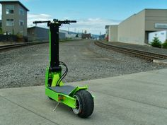 Rover electric scooter prepares to tackle road or dirt Best Electric Scooter, Electric Skateboard, Electric Cars, Electric Motor, Electric Vehicle, Electric Transportation, Transportation Technology, Scooter Bike, Kick Scooter