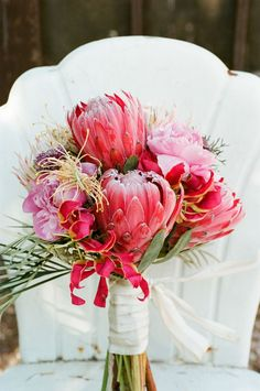 Giant Proteas - Pretty awesome wedding bouquet! See more of this whimsical wedding on #SMP here:   http://www.StyleMePretty.com/2014/05/02/quirky-elegance-at-three-points-ranch/ Photography: Q Weddings - qweddings.com -- Floral Design: http://LorettaFlower.blogspot.com