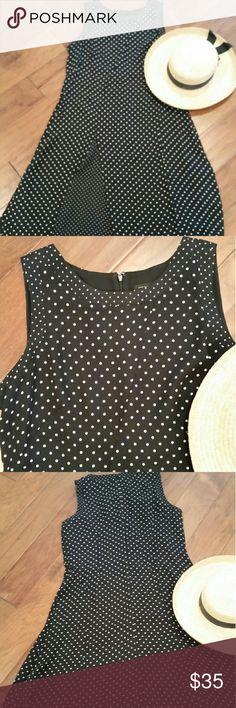 "Ann Taylor  gorgeous black/ polka-dot dress Beautiful!  Slight flair skirt with smaller polka-dot inset in front and around armholes and neckline.  100% polyester, fully lined,  19"" across back, armhole to armhole,  41"" long from neckline to hem, 31"" from armhole to hem. Ann Taylor Dresses Midi"