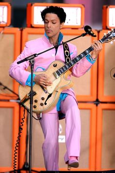 No Prince suit would be complete without matching heeled boots. Here, a dusty pink pair he wore when he performed on Good Morning America in Prince Images, Photos Of Prince, Prince Suit, My Prince, Prince Adore, Prince Rogers Nelson, Princes Fashion, The Artist Prince, Prince Purple Rain