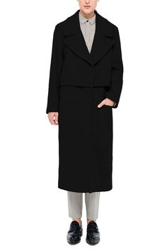 A long wool-blend black overcoat, the 'Stotzer' has an oversized fit with large lapels and a boxy overlay at the waist. Luxurious and effortless, it's perfect for cozying up throughout winter.  Stylish casual minimalist outfit | Minimalist casual wear | Capsule wardrobe | Slow fashion | Simple winter style | Minimalist style | Stylish business casual | Scandinavian casual wear | Stylish work outfit by Behno