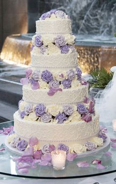 definitely going to be my wedding cake! less tiers though, i don't need a cake this big! the flowers are edible buttercream with pearl detailing!