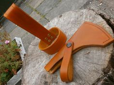 Matching axe mask & belt hanger in 4mm veg-tanned leather, dyed tan and stitched with linen thread.