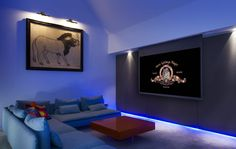 A multi-functional media room in Somerset with a host on concealed technologies.