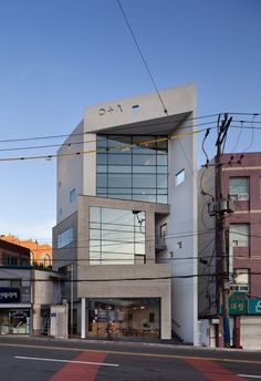 Image 17 of 42 from gallery of O+A Building / Architects Group RAUM. Photograph by Yoon Joon-hwan Office Building Architecture, Concept Architecture, Facade Architecture, Facade Design, Exterior Design, House Design, Building Elevation, Contemporary Building, House Entrance