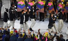 Opening Ceremony, Aug. 5: The glistening, shirtless Tongan flag bearer stole the show, but the most poignant moment of the opening ceremony was the entrance of the 10-person Refugee Team. Competing under the Olympic flag, the team consisted of five runners from South Sudan, two swimmers from Syria, two judokas from the Democratic Republic of Congo and one runner from Ethiopia. The team did not win a medal, but it shined ...  More...     -  One great photo from each day at the Rio Olympics