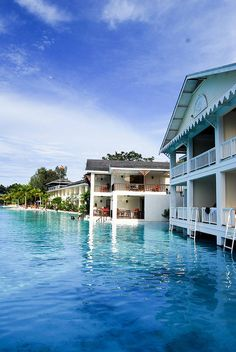 Plantation Bay Resort and Spa, Cebu, Philippines >>>I need to stay here! Look at the ladders coming out of the balconies into the water!
