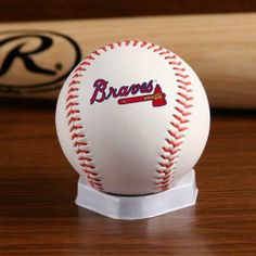 """Atlanta Braves """"The Original"""" Logo Baseball by Jarden. $7.95. Officially licensed by MLB. This Atlanta Braves baseball is a tried-and-true classic. Regulation-size white baseball with red stitching allows the Braves logo to take center stage. Each baseball features the Rawlings logo on the back and commissioner signature on the top. Packaged in a clamshell with a home plate display stand.. Save 12%!"""