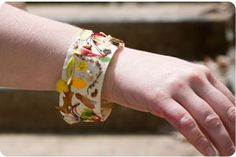Make a nature bracelet: Wrap a piece of tape around your child's wrist, then go outside and pick tiny treasures such as petals and seeds that you can stick onto the bracelet.