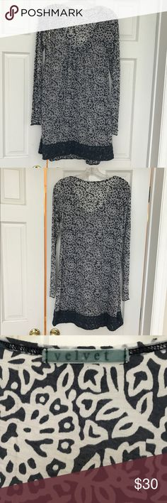 """Velvet Tunic Blue/White Floral w/ crochet detail L Like new condition.  Worn at most 2 times.  No signs of wear.  This top is fairly sheer so I bought it as a swim cover up but it is meant to be worn as a top with or without a camisole.  I am 5'7"""" and tunic goes down to right above the middle of my thigh.  Size Large.  Great for spring/summer!  Love it - just too big on me. Velvet Tops Tunics"""