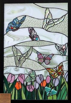 Stained glass butterflies over tulips