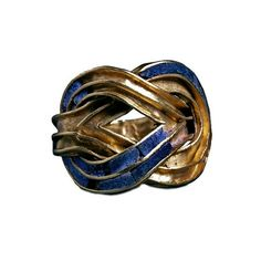 Goldknot and lapis lazuli ring from the Aigina treasure. Minoan, about 1850-1550 BC From Aigina, Aegean Sea.