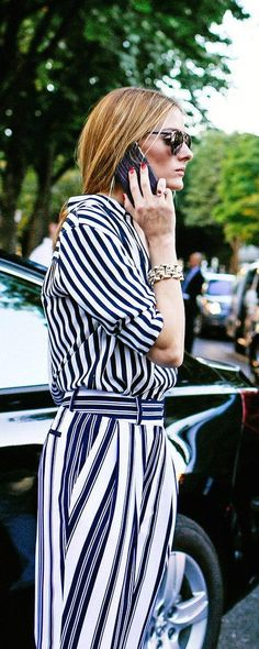 Olivia Palermo in a Tommy Hilfiger top, Witchery pants, and Christian Dior sunglasses