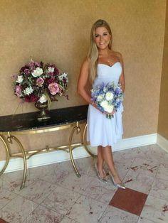 Bridesmaid bouquet.  Light blue iris, blue hydrangea, navy blue thistle,  delphinium, dusty miller, white roses.  Carousel of Flowers in Somerville, NJ
