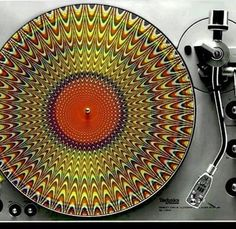 Psychedelic earth colors to this interesting 33-1/3 phonograph disk - KEEP PLAYING VINYL RECORDS - They give a different sound!