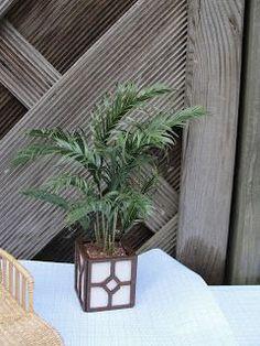 De Titanic in miniatuur.: Klimop en palm maken.