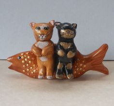 Two cats on fish bench