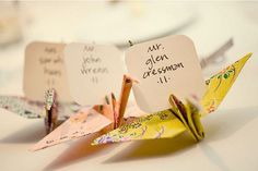 Purple and grey origami cranes could hold the name cards for the reception table seating.