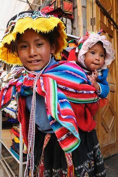 Girls in traditional dress, Pisac Sunday market, Peru by iancowe, via Flickr