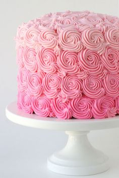 What better way to celebrate a baby girl then with a pink cake? The ruffled fondant mimics roses, while the ombre pink adds a whole bunch of pretty. Get the recipe at Glorious Treats.   - CountryLiving.com