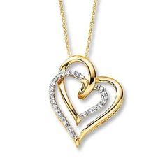 Show your heart on your wedding day with this yellow gold and diamond heart-shaped necklace.