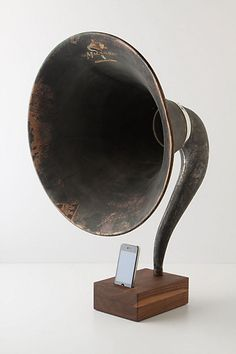 How awesome is this?! It's a repurposed antique speaker for your iPod.
