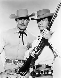 The Lawman     John Russell / Marshal Dan Troop    -     Peter Brown / Deputy Johnny McKay  I met Peter Brown in the 60's.  He put his hand on my left shoulder.  I said I would never wash that shoulder again.  LOL