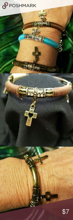 Bracelet cross themed 3 color choices. Bracelet cross themed 3 color choices . Stretch to wear. Two and 3/8 diameter.  Styles available are antique gold tone finish cross, antique gold tone with brown threaded accent for a burst of color and texture. Davinci Jewelry Bracelets