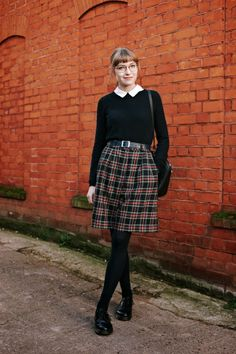 Black sweater with white collar & tartan