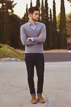 gray v neck sweater, blue button down, dark rolled jeans and light brown wingtips