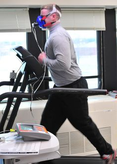 Spc. Michael Gavin, a resident of Fleetwood, Pa., and a combat medic with the 7221st Medical Support Unit, Newark, Del., runs on a treadmill while breathing through a mask connected to a monitor that tracks how well he processes oxygen, Feb. 9, 2014, so clinicians at the Army Wellness Center, Aberdeen Proving Ground, Md., can determine his metabolism.  Once the metabolism is determined, using measurements from the soldier at rest and exerting, clinicians can tell him how many calories are…