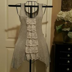 Lovely Sharkbite Lace Lacey detail down front of this long soft tank. Gorgeous Tops Tank Tops