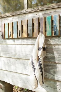 recycled wood coat rack with hand forged hooks