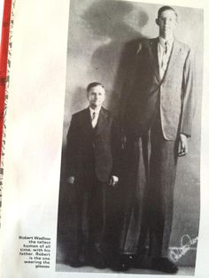 Robert Wadlow, the tallest human of all time, with his father. Robert is the one wearing the glasses. - funny caption