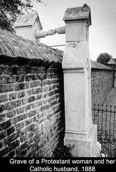 Wall in Belfast cemetery,  separating Protestant from Catholic! One mixed marriage couples solution. Religion really does poison everything!
