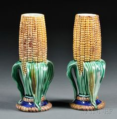 Pair of Wedgwood Majolica Cornhusk Vases, England, c. 1869, each with naturalistic modeling and enamels, impressed marks, ht. 6 5/8 in.  |  SOLD $948