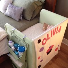DIY cosleeper... so cute. Was thinking of a similar soft canvas hanging storage and the personalized quilt back is a nice touch.