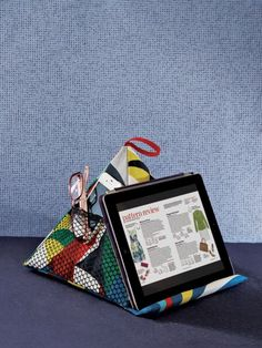 This crafty project from Threads #179 (June/July 2015) is easy to make and has a ton of possible uses.Rest a book, tablet, e-reader, or favorite sewing magazine at the perfect angle on this pyramid-shaped pillow. This easy-to-sew project is the smart way to achieve comfort while reading or watching videos-in bed, next to your sewing machine, or anywhere you need a prop for a book or device.