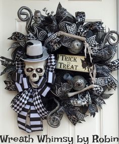 Black & Silver Deluxe Skeleton with Top Hat Deco Mesh Halloween Wreath.  Delight visitors this fall with this eerily elegant custom designed skeleton deco mesh wreath. Black deco mesh layered with silver mesh rolls and then embellished with some beautiful ribbon streamers including; a satin skeleton print, black/silver greek key, glitter swirl and spider web print. Check out the details on the mischievous 8 inch skeleton. The bow tie is made with a modern large white & black striped ribbon…
