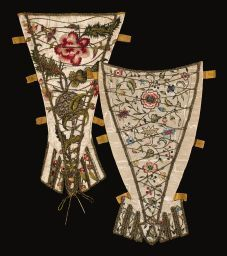 Stomacher with Crossed Cords (front and back) Stamacher with crossed cords (front and back)1720-1740; Britain; Gift of Mrs. Cora Ginsburg; Silk embroidered with silk and metallic threads, lined with block-printed cotton.