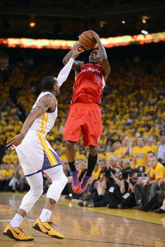 Description of . The Golden State Warriors' Andre Iguodala (9) can't stop the Los Angeles Clippers' Jamal Crawford (11) from scoring in the fourth quarter in game 6 of their Western Conference NBA playoff game at Oracle Arena in Oakland, Calif., on Thursday, May 1, 2014.(Dan Honda/Bay Area News Group)