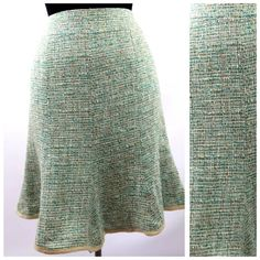 """Nanette Lepore Green Tweed Ruffle Skirt 2 28"""" Nanette Lepore Tweed Skirt   Size 2  Retail $248    Gorgeous fun skirt by Nanette Lepore.  Aqua, teal, ivory, brown & beige tweed.  Features a beige trim along the ruffle flare hem.  Fully lined, back zip with two buttons.   43% acrylic, 32% cotton, 22% viscose, 5% linen, 5% nylon.  Lining 100% acetate.  All measurements are taken with garment lying flat.  Waist 28""""  Hips 36""""  Length of garment 22"""" Nanette Lepore Skirts"""